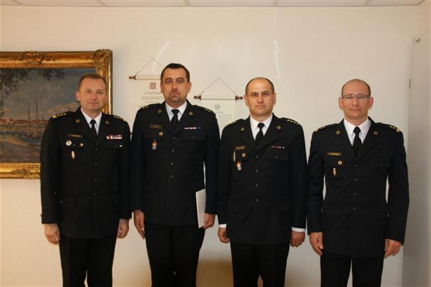 St. bryg. Adam Konieczny, mł. kpt. Grzegorz Fleszar, st. kpt. Artur Czułajewski, bryg. Łukasz Winkowski (fot.: KW PSP Wrocław)
